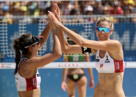in this Aug. 4, 2019, file photo, Canada's Melissa Humana-Paredes and Sarah Pavan, fom left, celebrate after winning women's gold medal match against Brazil's team at the Beach Volley Worldtour Major Series, in Vienna, Austria. (AP Photo/Ronald Zak)