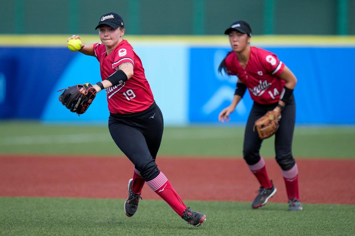 Canada's Emma Entzminger makes a throw against Mexico during Tokyo 2020 softball tournament