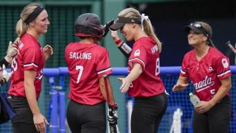 Canadian Olympic softball team celebrates a home run
