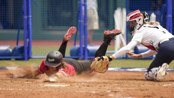 Canada's Joey Lye, left, is tagged by United States' Aubree Munro at home plate during the softball game between the United States and Canada at the 2020 Summer Olympics.