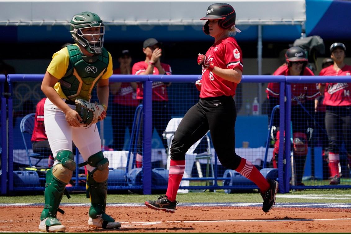Victoria Hayward crosses home plate