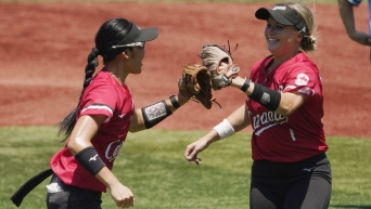 Janet Leung and Kelsey Harshman celebrate