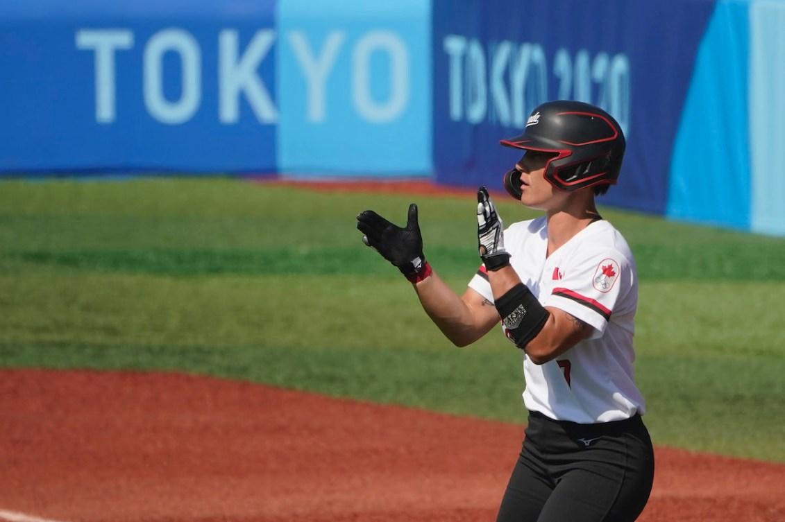 Canada's Jenn Salling celebrates a single in the second inning of a softball game against Japan in Yokohama Baseball Stadium, at the 2020 Summer Olympics, Sunday, July 25, 2021, in Yokohama, Japan.