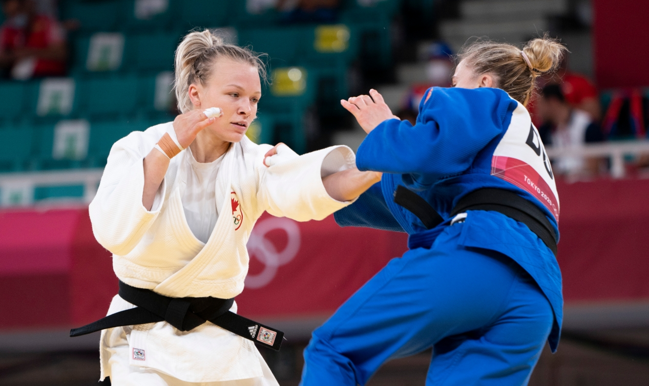 Canada's Jessica Klimkait reaches for opponent in the women's 57kg competition.