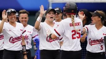 Jennifer Gilbert celebrates with her teammates