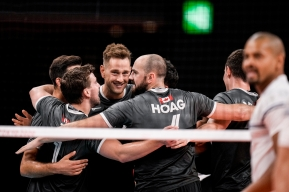 Canadian volleyball players celebrating on the court