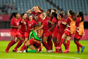 Canadian players celebrate after defeating Brazil