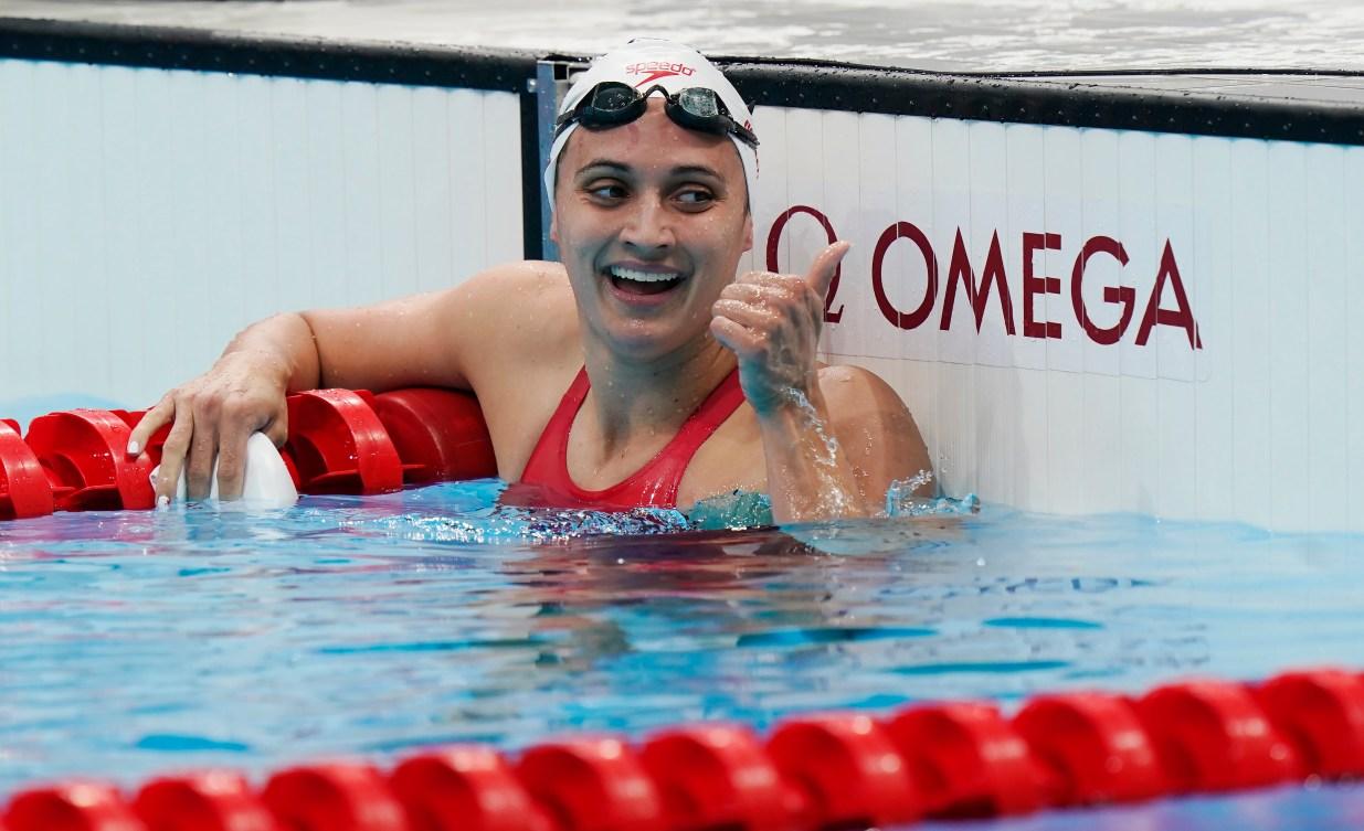 Kylie Masse celebrates after winning a medal