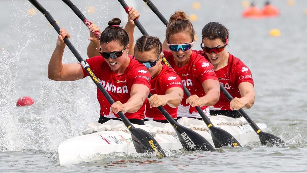 Crew of four women kayakers racing
