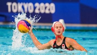 Axelle Crevier holds the ball against Australia