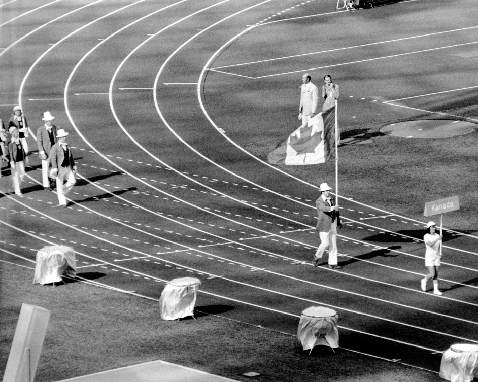 Doug Rogers carries Canadian flag into Olympic Stadium
