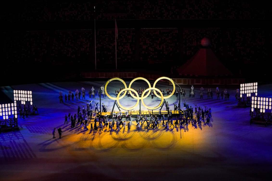 Wooden Olympic Rings are pictured at the Opening Ceremony, surrounded by performers.