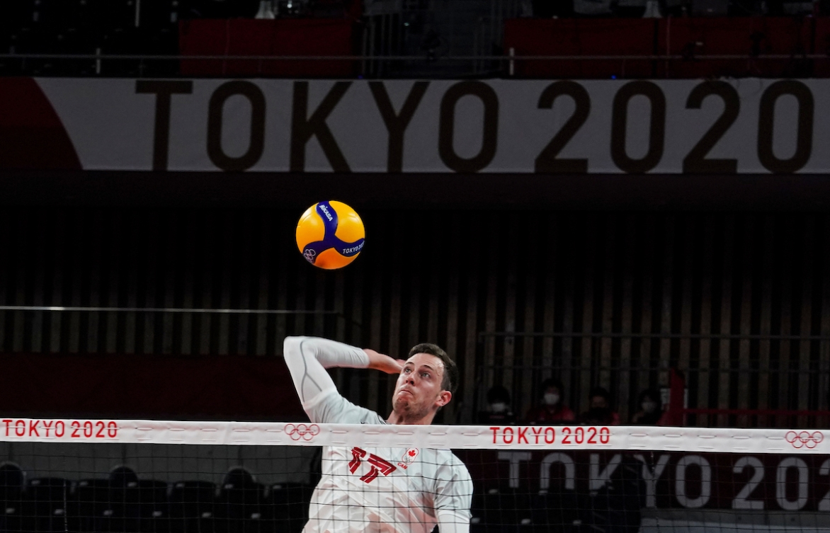 Canada's middle blocker Graham Vigrass #17 hits the ball against Italy during the menís preliminary round at Ariake Arena during the Tokyo 2020 Olympic Games on Saturday,July 24, 2021. Photo by Leah Hennel/COC