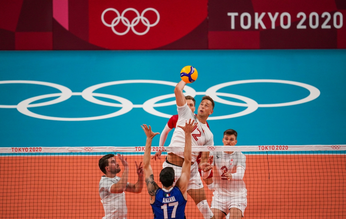 Canada middle blocker Lucas van Berkel #12 spikes the ball as Italy middle blocker Simone Anzani #17 attempts to block during the menís preliminary round at Ariake Arena during the Tokyo 2020 Olympic Games on Saturday,July 24, 2021. Photo by Leah Hennel/COC