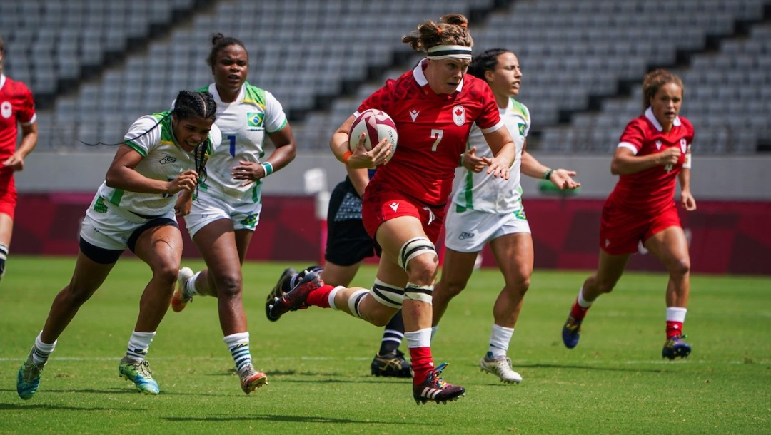 Team Canada's Karen Paquin runs the ball against Brazil