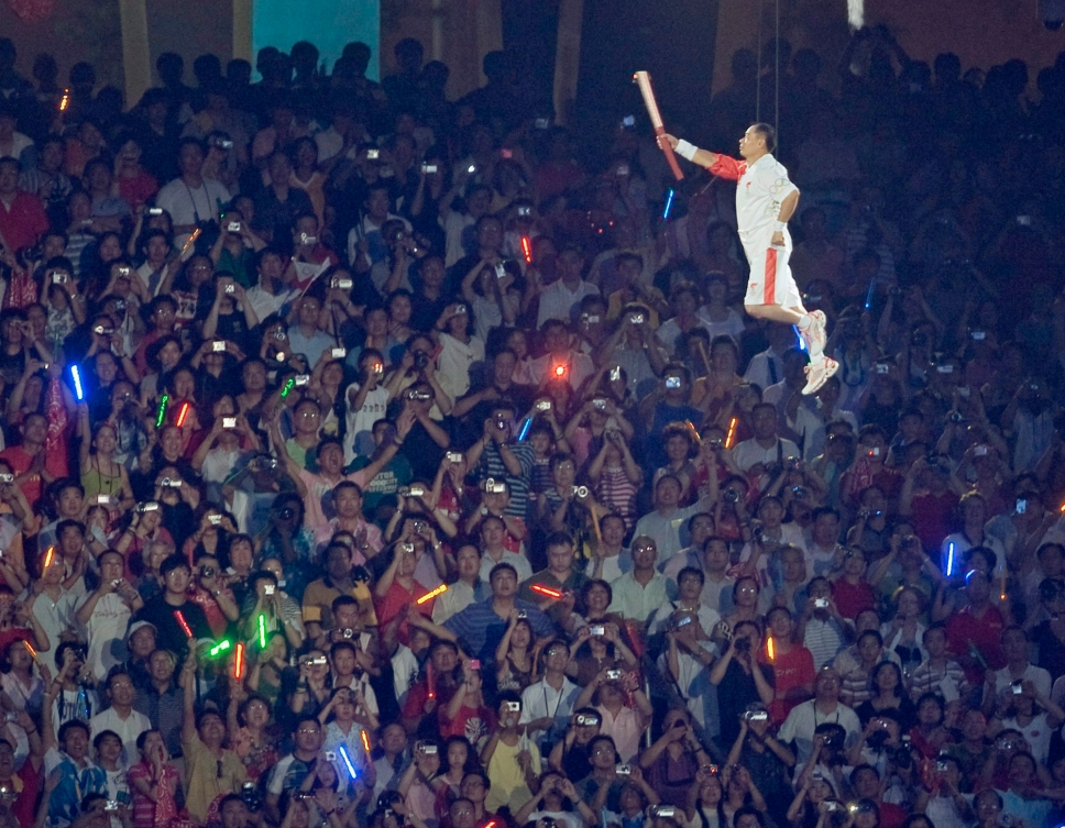 Li Ning with Olympic torch