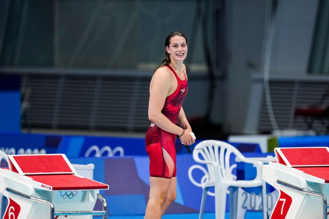 Penny Oleksiak smiles on the pool deck