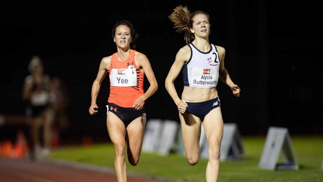 Two women running on track
