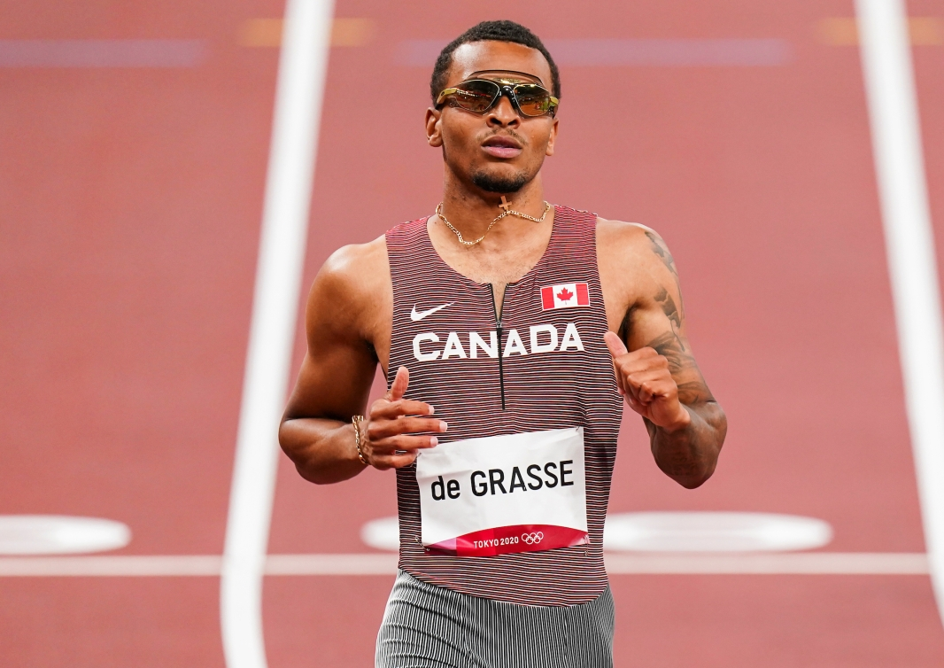 Andre De Grasse at the end of his heat