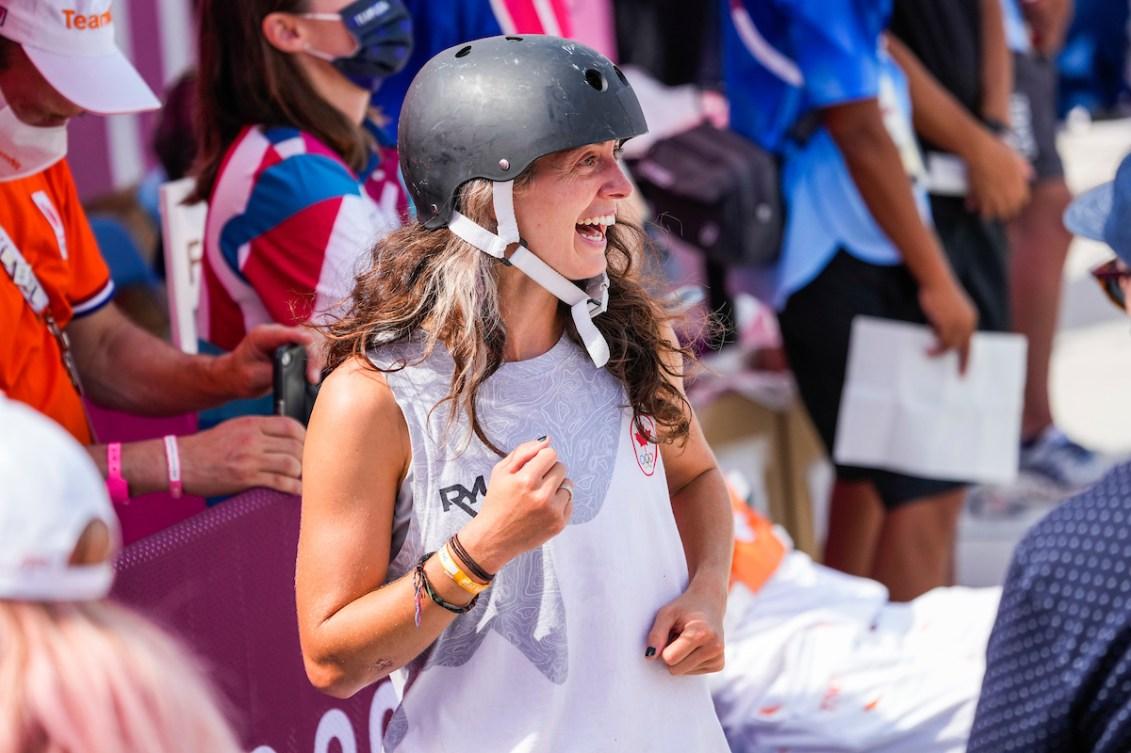 Annie Guglia smiles in skateboarding gear