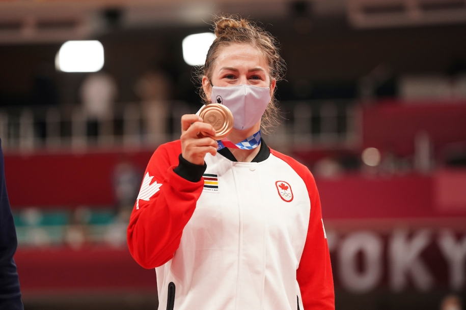 Christine Beauchemin-Pinard shows her Olympic bronze medal