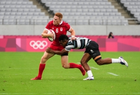 Canada's Connor Braid breaks tackle during the Olympic men's rugby.