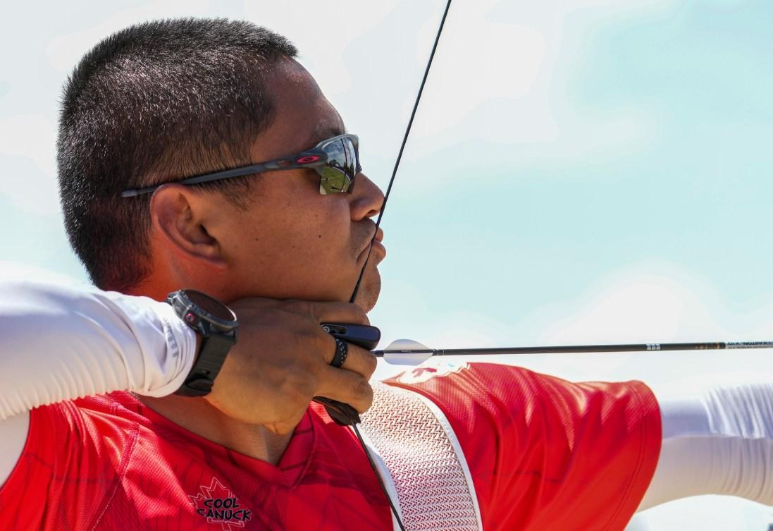 Crispin Duenas pulls his arrow into his bow