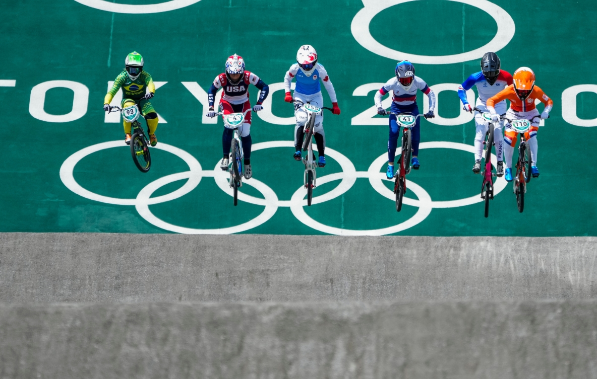 BMX riders race to the finish line