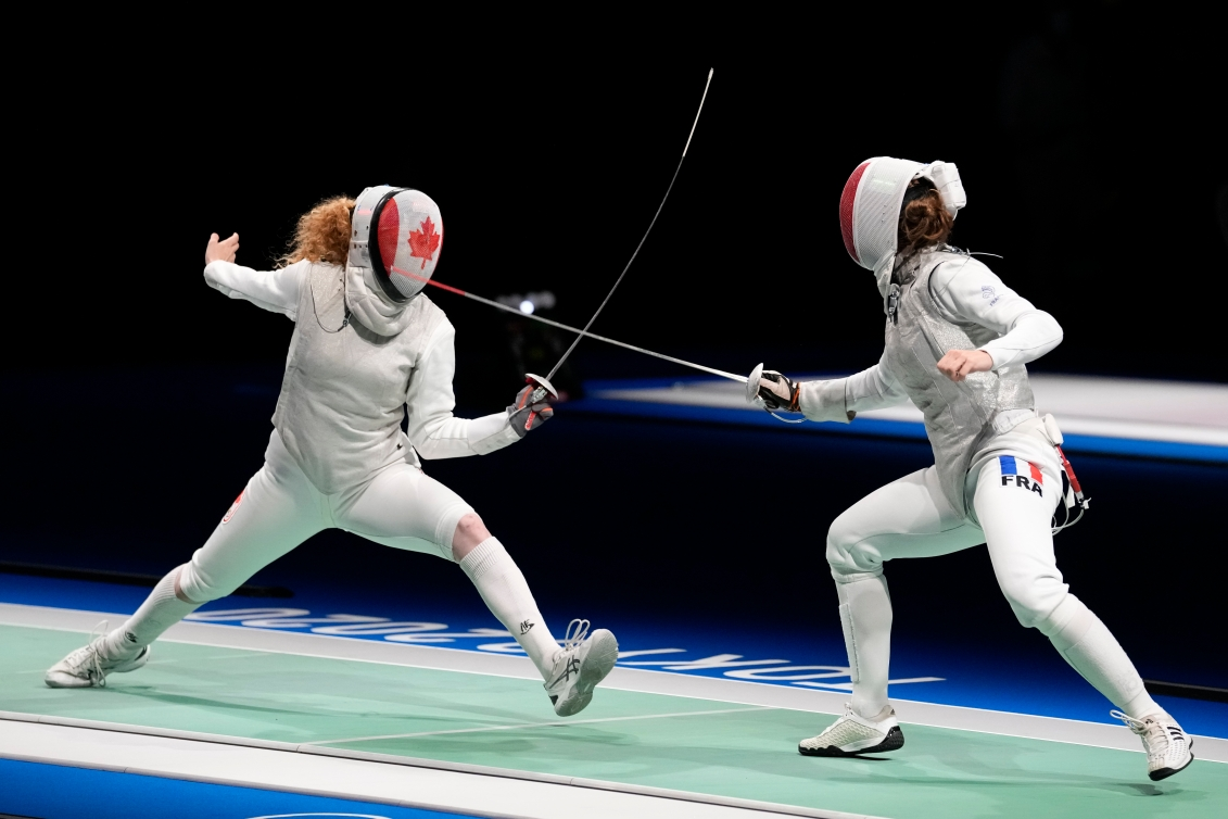 Eleanor Harvey competing against France in fencing