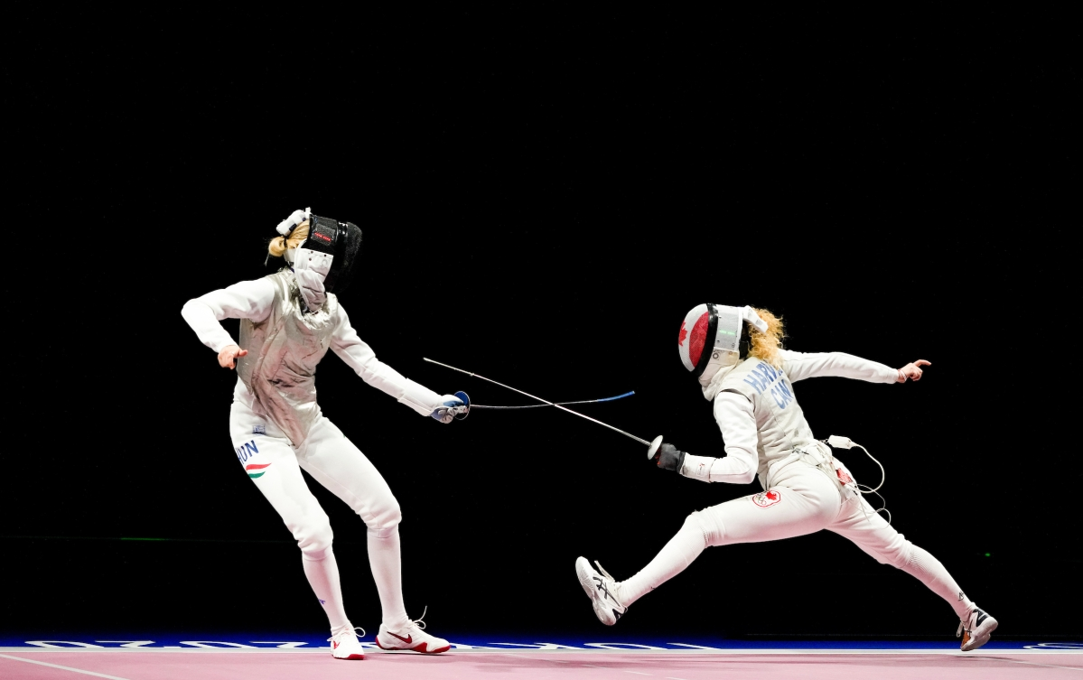 Two fencers in a match