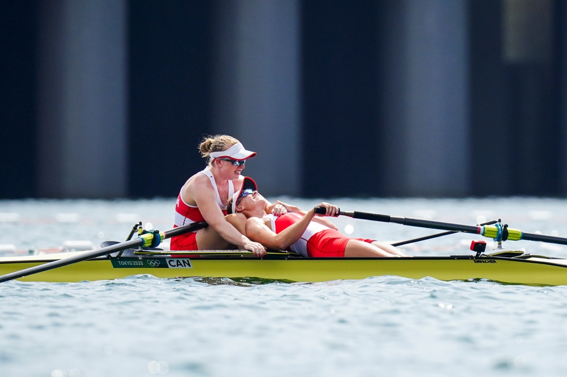 Hillary Janssens collapses on partner Caileigh Filmer after their rowing bronze