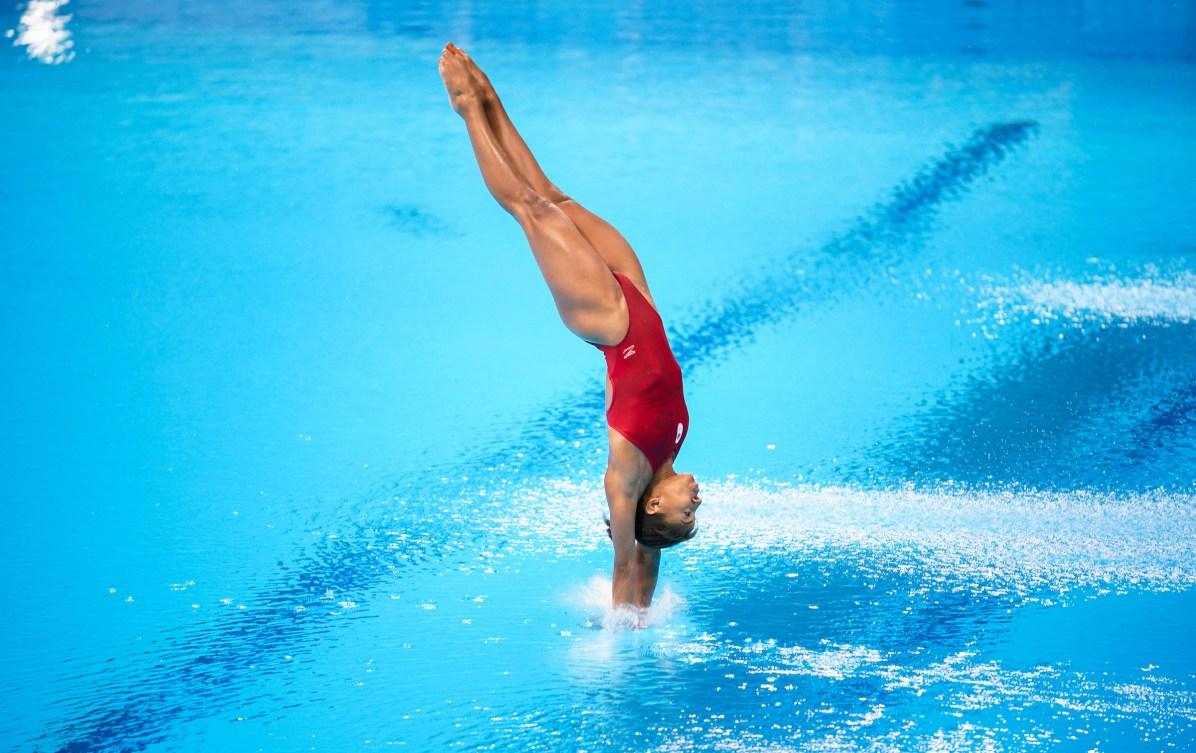Jennifer Abel breaks the water on a dive