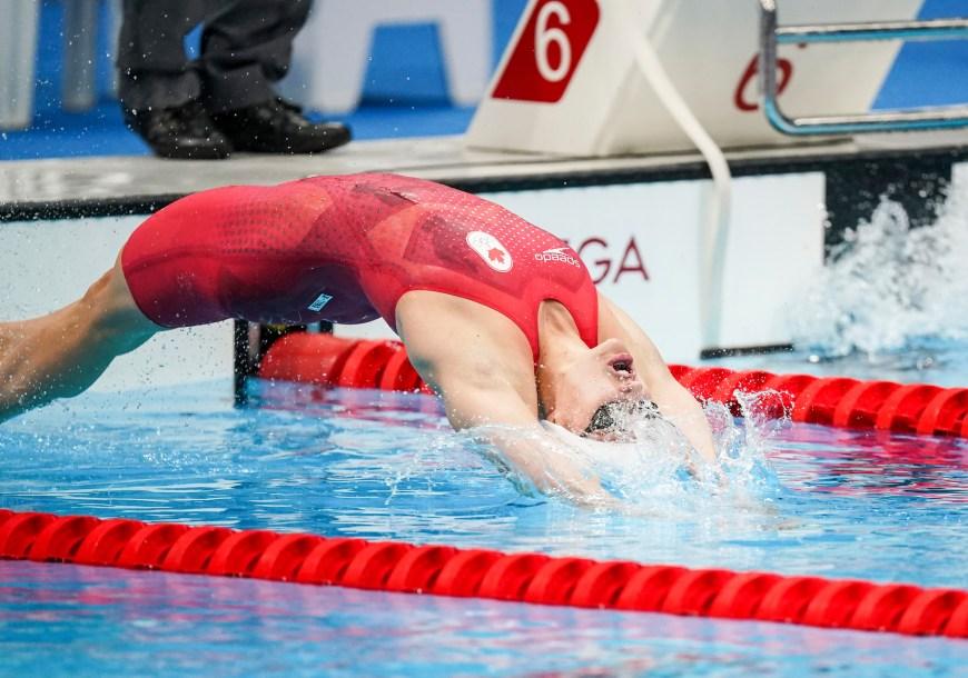 Kylie Masse dives in for start of 100m backstroke