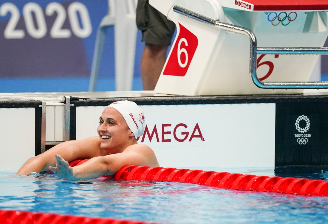 Kylie Masse smiles after winning silver