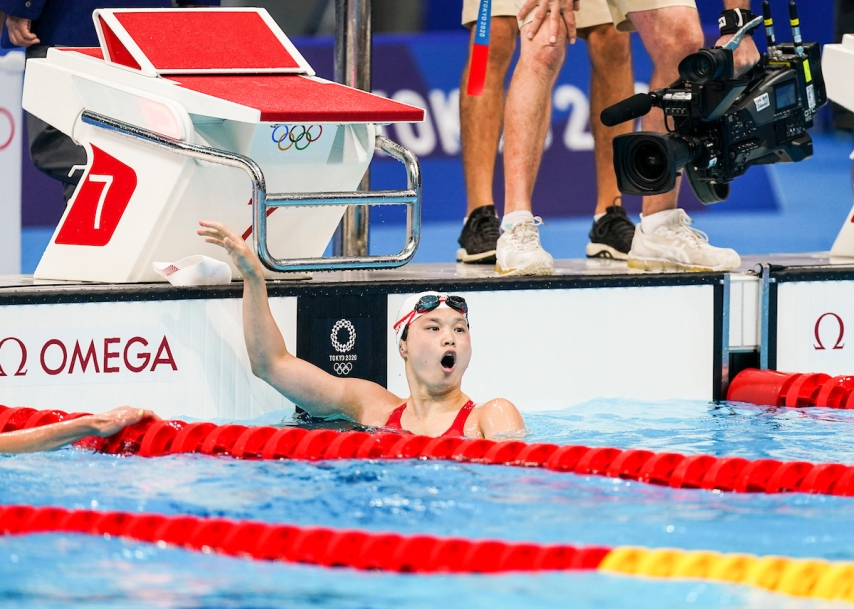 Maggie Mac Neil gasps at the result after winning gold