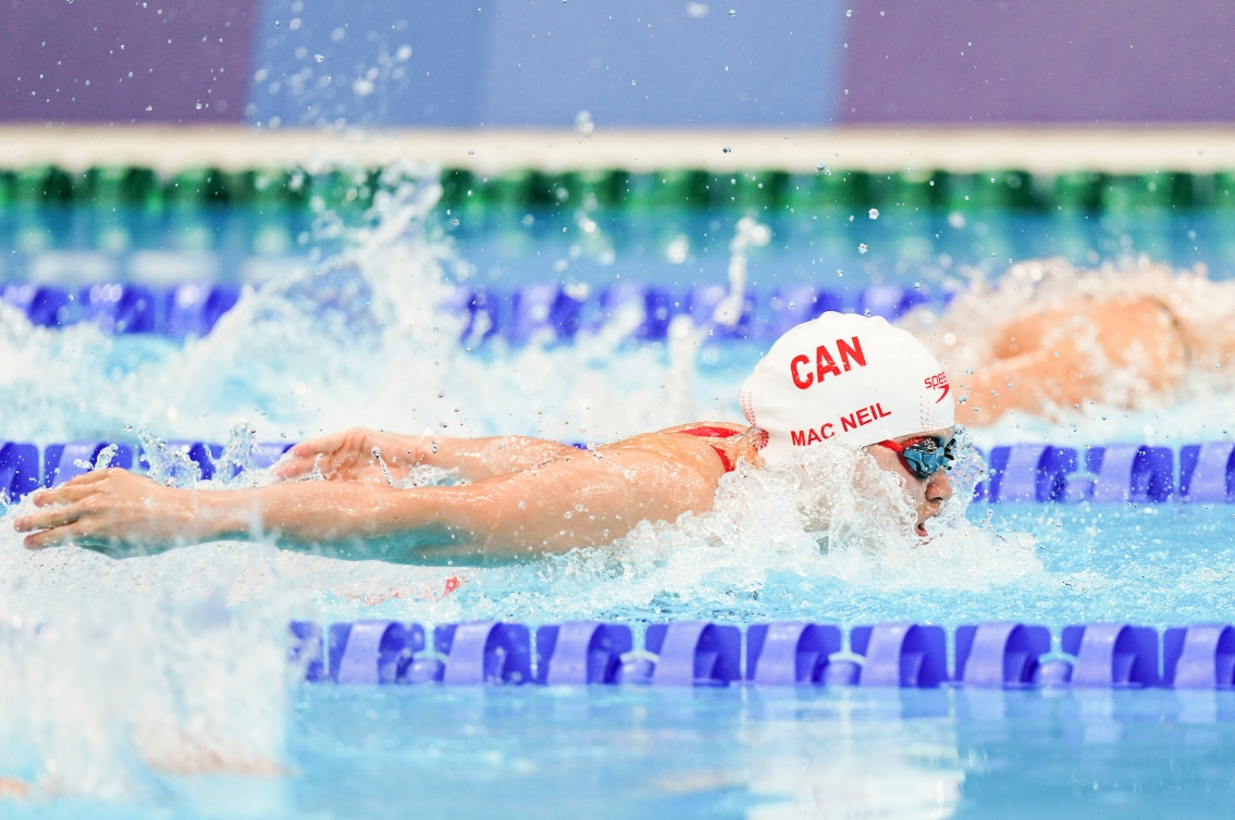 Maggie MacNeil swimming the 100m butterfly