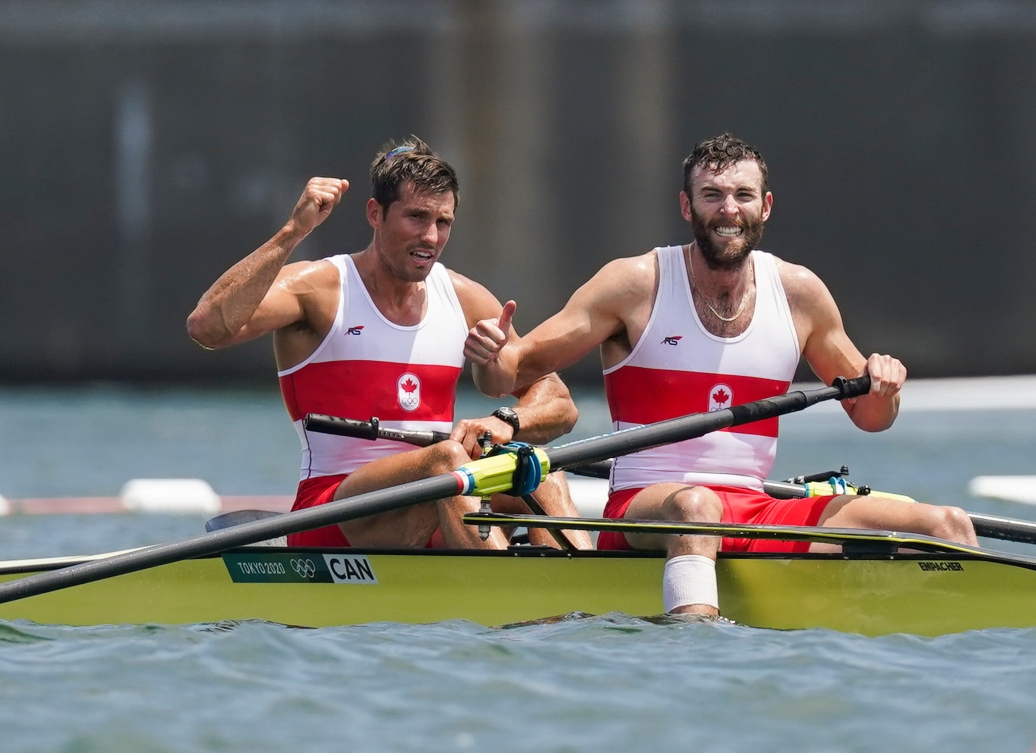 Two rowers celebrate in their boat