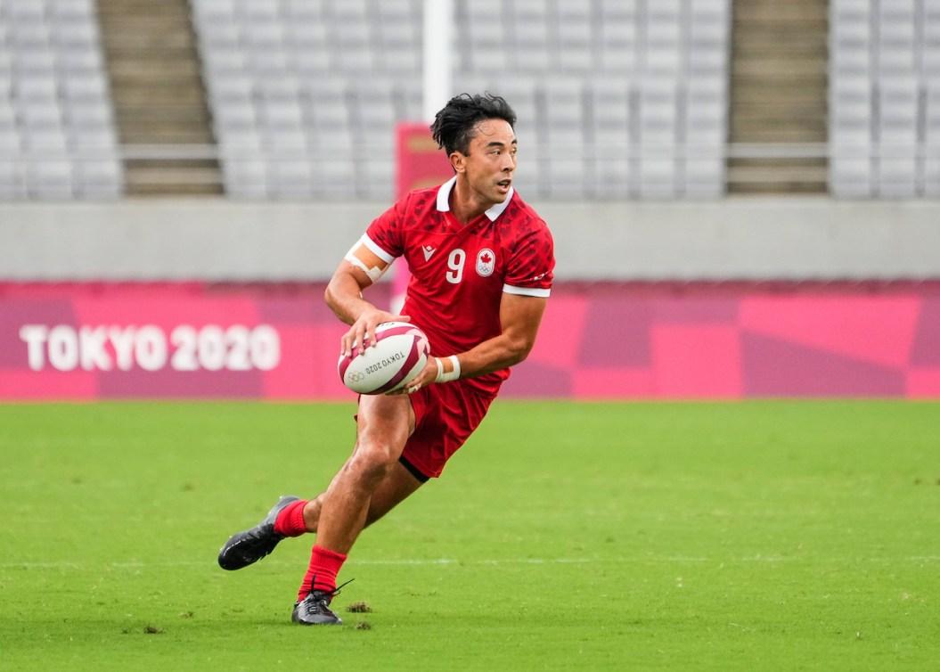 Nathan Hirayama carries the ball on the pitch at Tokyo 2020.