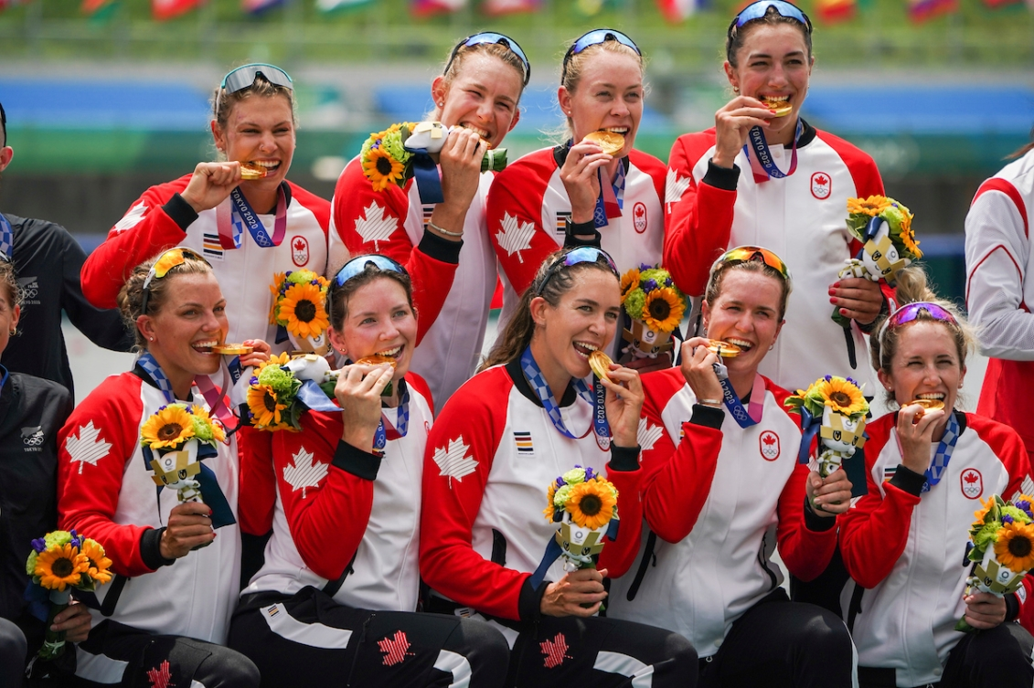 Team Canada women's eight crew take a photo with gold medals