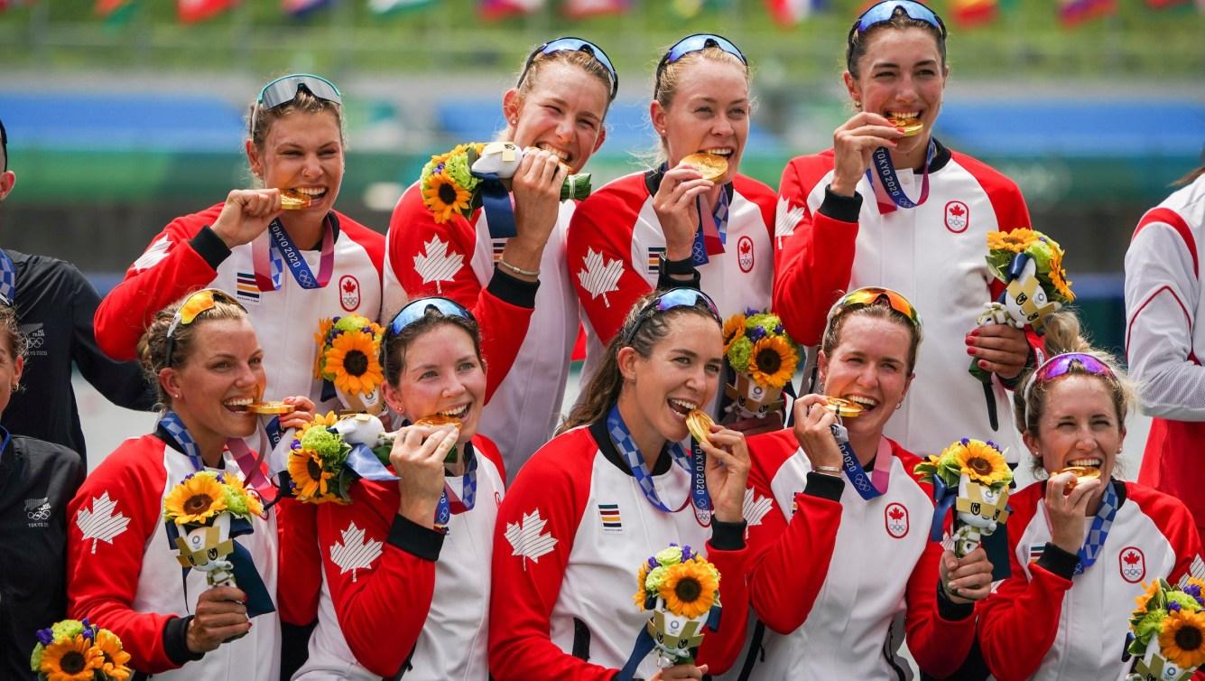 Team Canada women's eight crew bite their medals