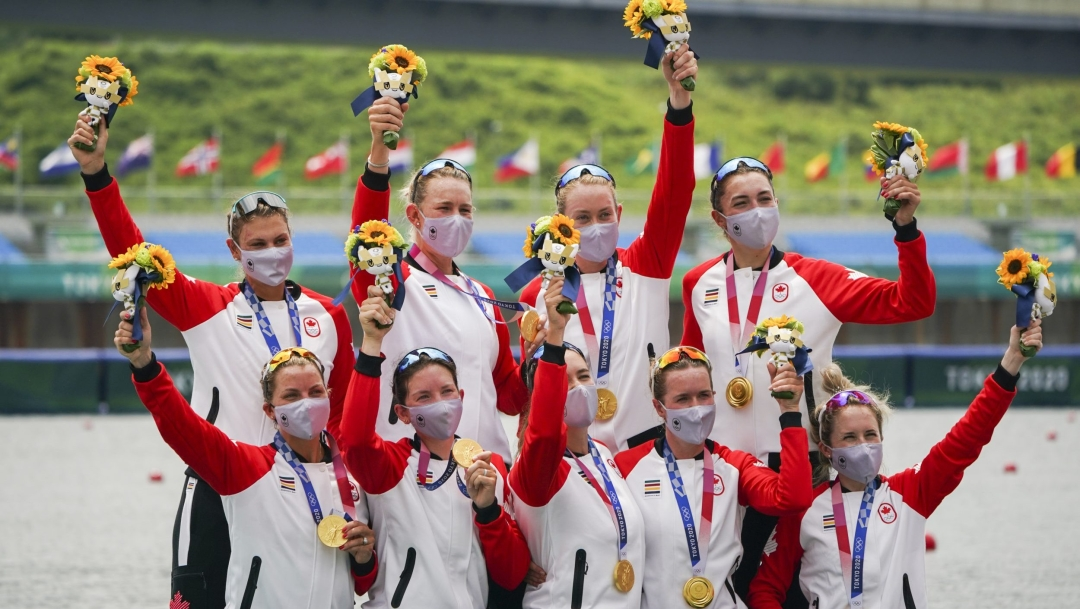 Canadian rowing eight women's team wear their medals