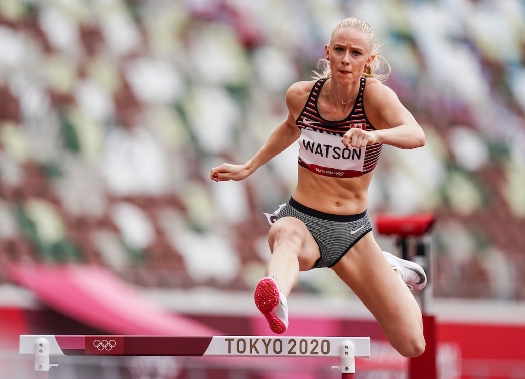 Sage Watson jumps over a hurdle in Tokyo 2020 Olympic Games.