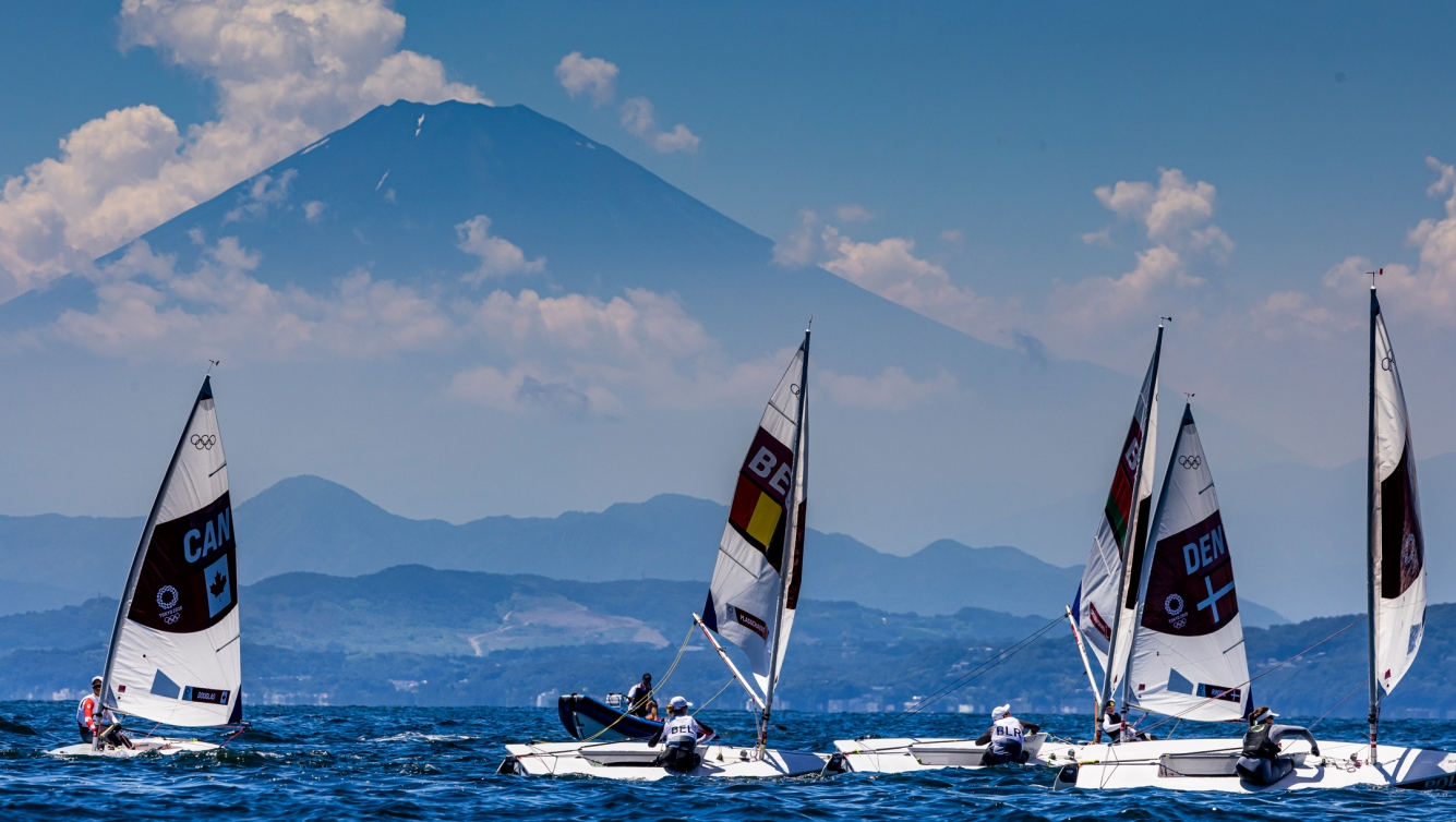 Wide shot of sailboats in front of Mount Fuji
