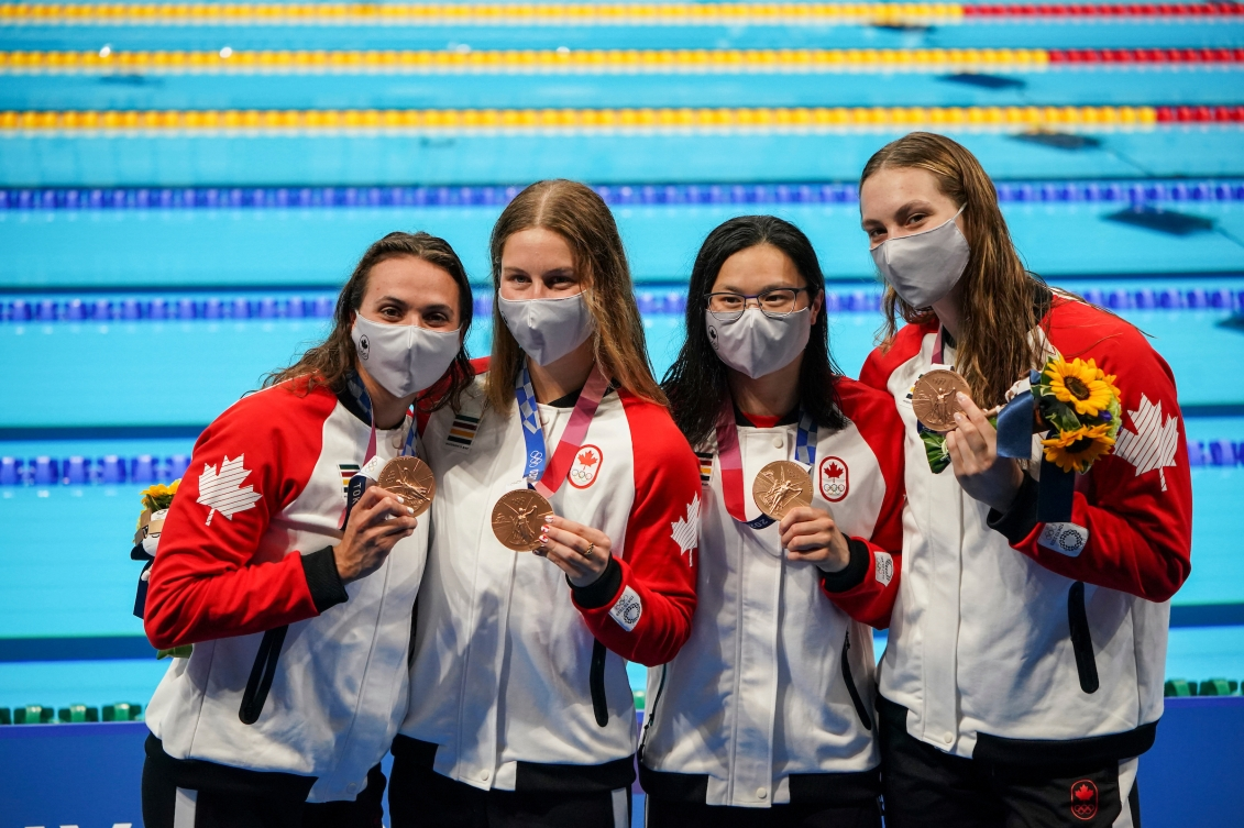 Canadian swimmers pose with their medals