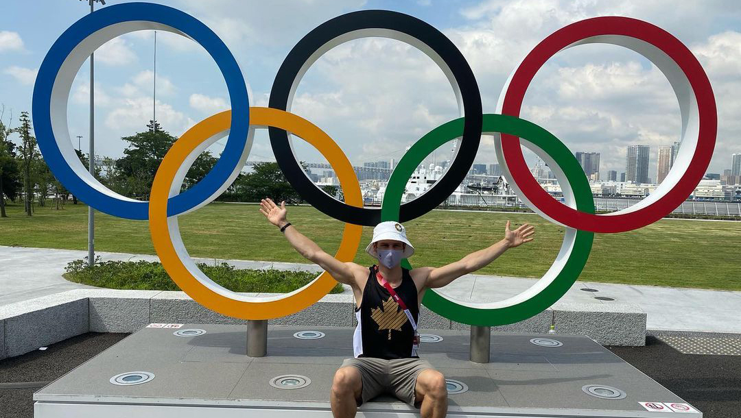 Vincent Riendeau poses in front of the Olympic Rings