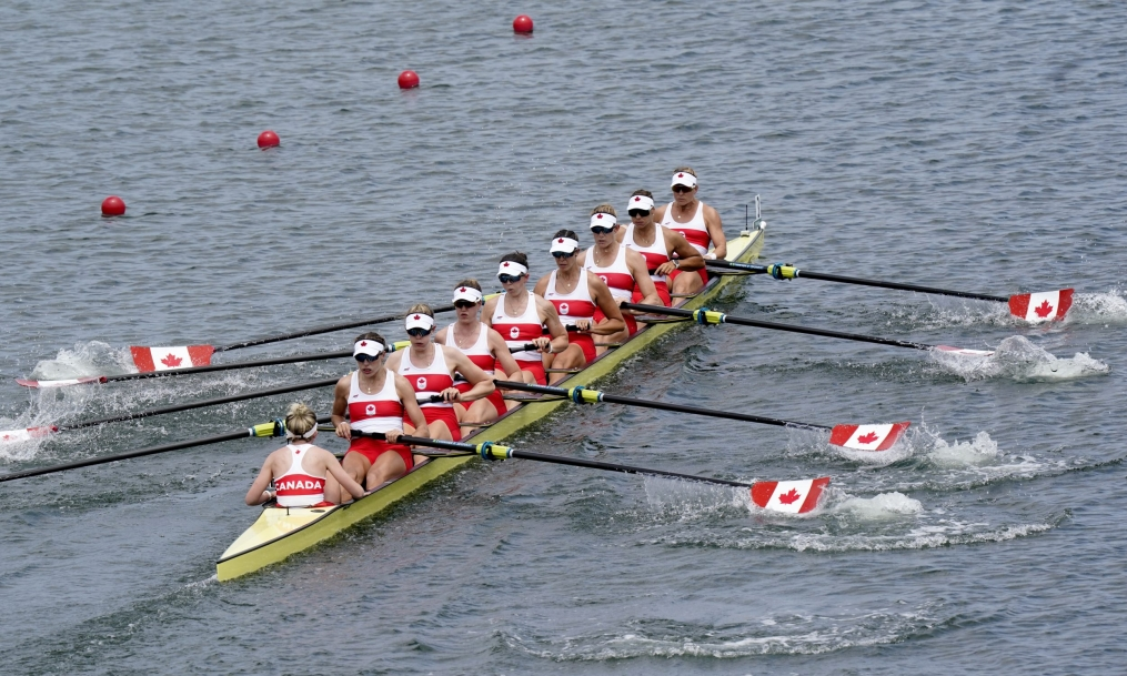Wide photo of the Canadian women's eight rowing crew in race action