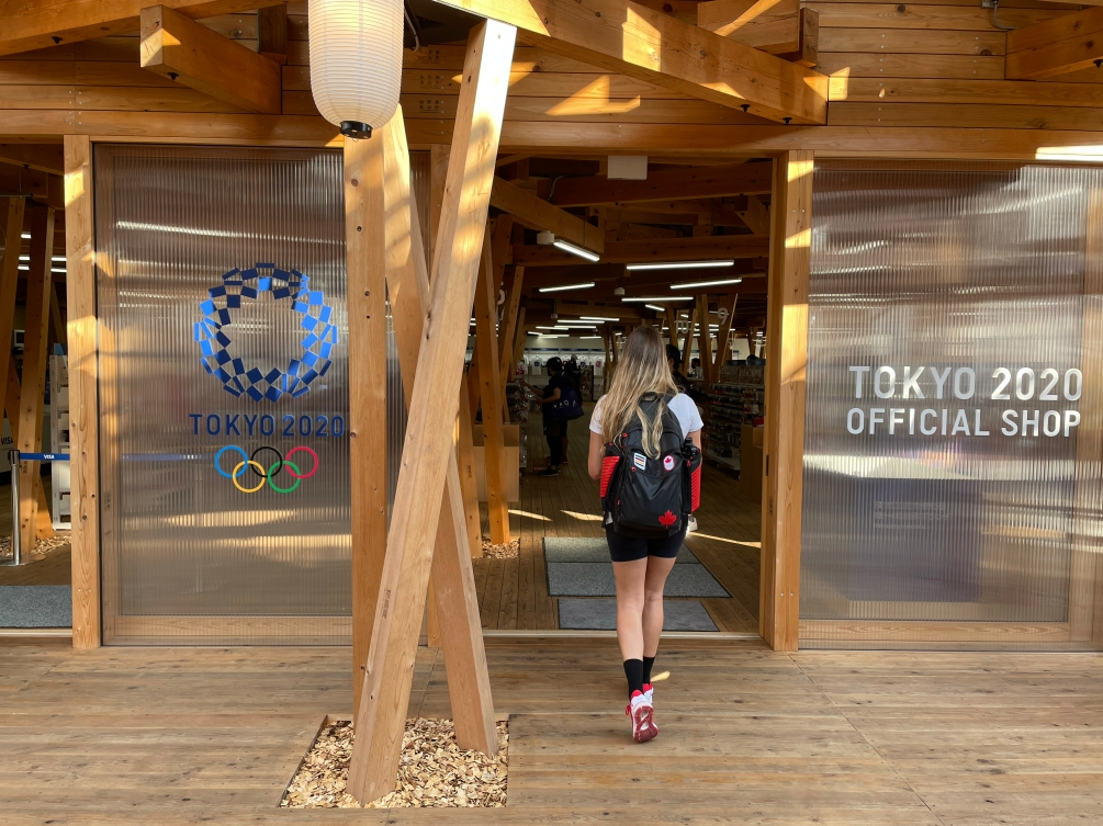 Store front of the Tokyo 2020 official shop made of wood larch with the Tokyo logo on the front window