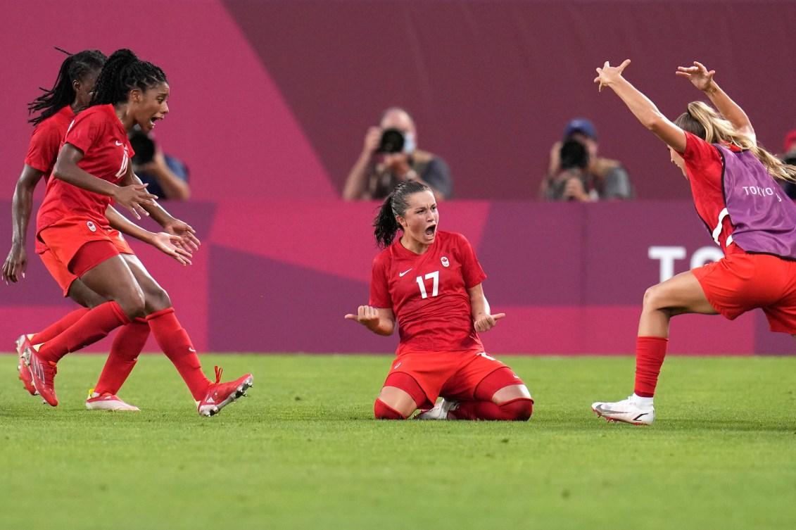 Jessie Fleming celebrates with teammates