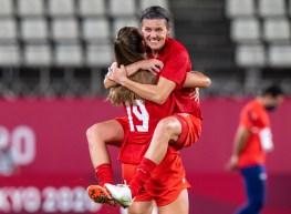 Christine Sinclair celebrates in teammate Jordyn Huitema's arms