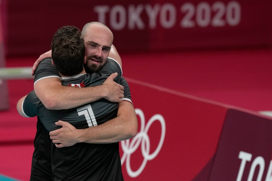 Canada's Nick Hoag and TJ Sanders hug after the match